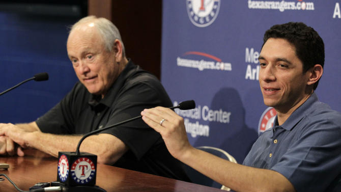 Texas Rangers team president Nolan Ryan, left, and general manger Jon Daniels, right, take questions regarding the signing of veteran Roy Oswalt during a press conference during  a baseball game against the Seattle Mariners Tuesday, May 29, 2012, in Arlington, Texas. (AP Photo/Tony Gutierrez)