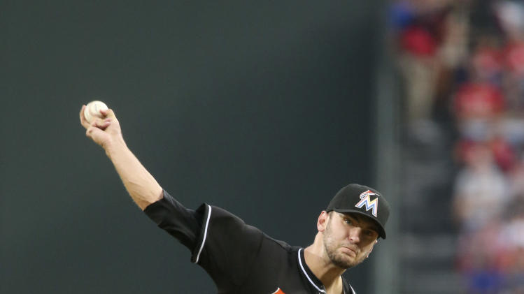 Miami Marlins starting pitcher Jarred Cosart (23) delivers a pitch in the first inning of a baseball game against the Atlanta Braves, Saturday, Aug. 30, 2014, in Atlanta. (AP Photo/Jason Getz)