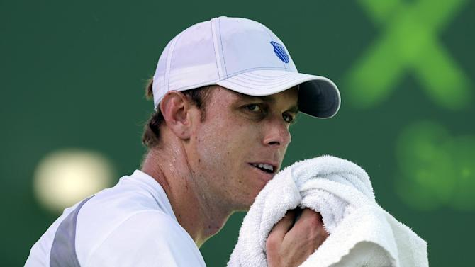 Sam Querrey wipes his face during a match against Tomas Berdych, of the Czech Republic, at the Sony Open tennis tournament, Tuesday, March 26, 2013, in Key Biscayne, Fla. Berdych won 6-1, 6-1. (AP Photo/Lynne Sladky)