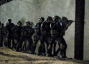 "This film image released by National Geographic Channels shows actors portraying members of SEAL Team Six who raided the compound of Osama Bin Laden in ""SEAL Team Six: The Raid on Osama bin Laden."" The TV film premieres on Nov. 4. (AP Photo/National Geographic Channels, Geronimo Nevada, LLC.)"