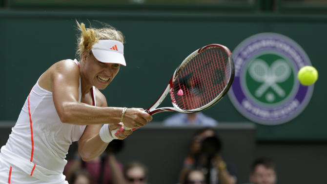 Angelique Kerber of Germany plays a shot to Agnieszka Radwanska of Poland during a semifinals match at the All England Lawn Tennis Championships at Wimbledon, England, Thursday, July 5, 2012. (AP Photo/Anja Niedringhaus)
