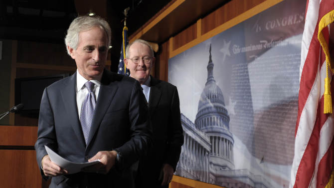 FILE - In this Dec. 28, 2012, file photo, Sen. Bob Corker, R-Tenn., left, and Sen. Lamar Alexander, R-Tenn., leave a news conference where they discussed the fiscal cliff on Capitol Hill in Washington. Corker will be the top Republican on the Foreign Relations Committee in the 113th Congress. (AP Photo/Susan Walsh, File)