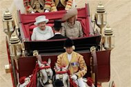 Queen Elizabeth travels by carriage to Buckingham Palace with Camilla, Duchess of Cornwall and Prince Charles after a Diamond Jubilee lunch at Westminster Hall in London