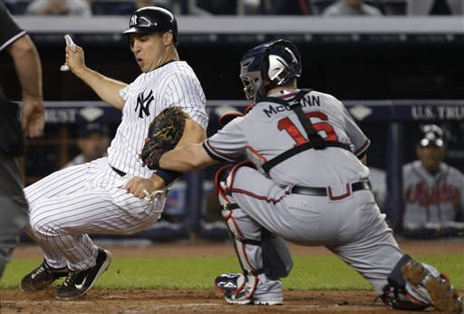 Braves hold on, end Yankees' 10-game win streak