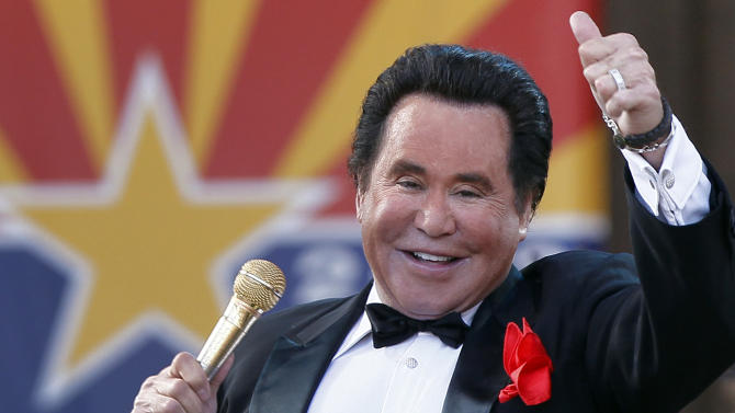 "FILE - In this Feb. 14, 2012 file photo, Entertainer Wayne Newton performs during the 100th Anniversary celebration of Arizona's statehood, at the Capitol in Phoenix. The company that purchased the rights to convert Newton's home into ""Graceland West"" filed a lawsuit this week in Las Vegas against Newton, his wife and her 76-year-old mother that claims the family unreasonably delayed the project to ensure it never opens. (AP Photo/Matt York, File)"