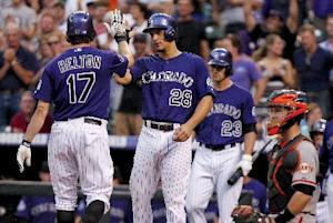 Helton homers as Rockies beat Giants 6-1