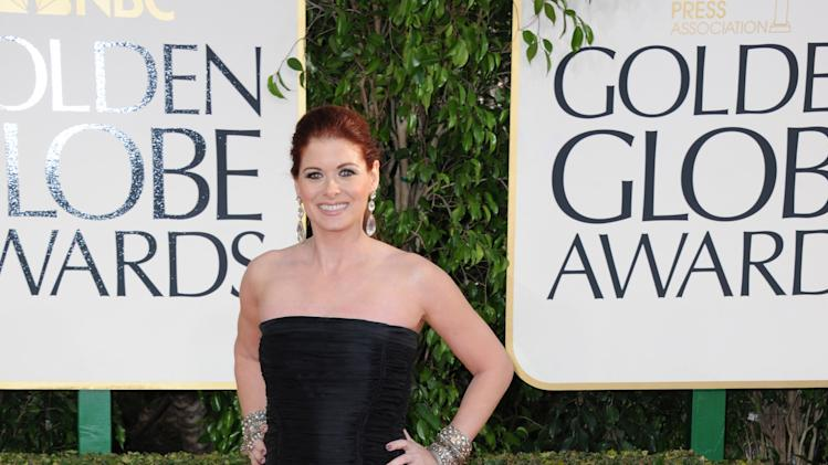 Actress Debra Messing arrives at the 70th Annual Golden Globe Awards at the Beverly Hilton Hotel on Sunday Jan. 13, 2013, in Beverly Hills, Calif. (Photo by Jordan Strauss/Invision/AP)