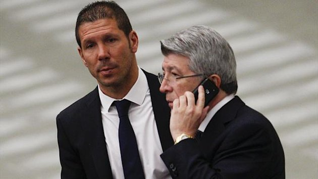 Enrique Cerezo and Diego Simeone of Atletico Madrid (REUTERS)