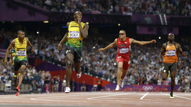 Jamaica's Usain Bolt second left, reacts as he crosses the finish line to win the men's 200-meter final during the athletics in the Olympic Stadium at the 2012 Summer Olympics, London, Thursday, Aug. 9, 2012. (AP Photo/Anja Niedringhaus)