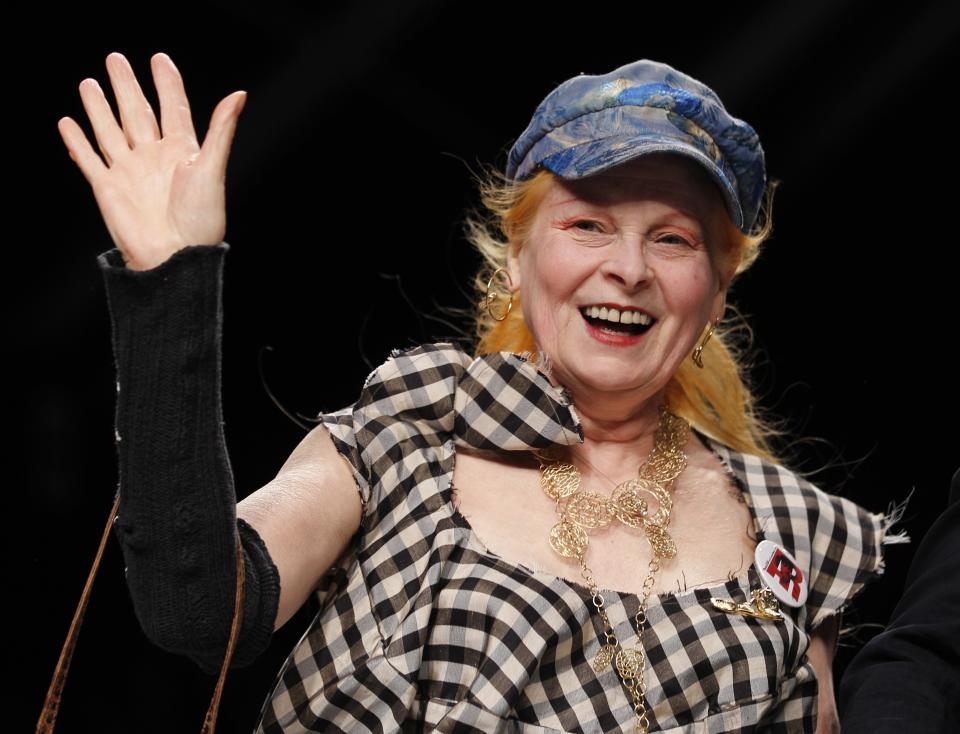 British fashion designer Vivienne Westwood waves to the audience after presenting the Vivienne Westwood fashion collection, from the men's Spring-Summer 2013 collection, part of the Milan Fashion Week, unveiled in Milan, Italy, Sunday, June 24, 2012. (AP Photo/Luca Bruno)