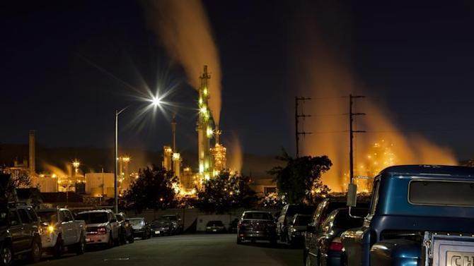 The ConocoPhillips oil refinery lights up a neighborhood in San Pedro