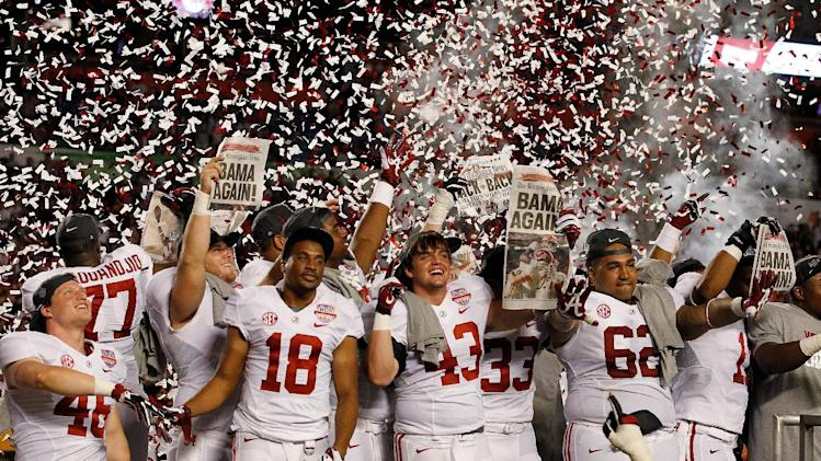 Alabama players celebrate after the BCS National Championship college football game against Notre Dame Monday, Jan. 7, 2013, in Miami. Alabama won 42-14. (AP Photo/Wilfredo Lee)
