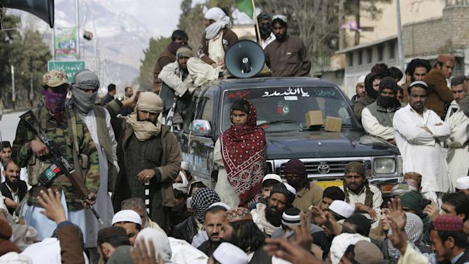 """In this Friday, Feb. 22, 2013, photo, supporters of Pakistani Sunni group, Ahle Sunnat Wal Jamaat attend a rally to condemn killings of their party activists by allegedly security forces, in Quetta, Pakistan. Pakistan's minority Shiite Muslims have begun to use words like """"genocide"""" to describe a violent spike in attacks directed against them by a militant Sunni group, with suspicious links to the country's security agencies and a mainstream political party that governs the largest province, where some of the most violent jihadi groups are headquartered. (AP Photo/Arshad Butt)"""