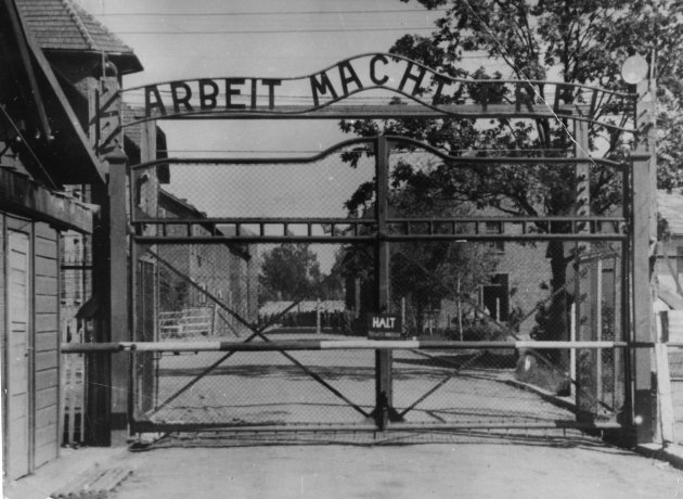 "Undated file photo shows the main gate of the Nazi concentration camp Auschwitz, in Poland, which was liberated by the Russians, in January 1945. Writing over the gate reads: ""Arbeit macht frei"" (Work liberates). German prosecutors have arrested three elderly men on suspicion they served as guards at the Nazis' Auschwitz death camp. Stuttgart prosecutors' spokeswoman Claudia Krauth said Thursday Feb. 20, 2014 the three men, aged 88, 92 and 94, were all taken to a prison hospital where they will be held as the investigation continues. The men, whose names were not released, are all suspected of accessory to murder as guards at the death camp in occupied Poland. They are part of a group of some 30 suspected former Auschwitz guards that German federal prosecutors recommended charges against last September. (AP Photo,File)"