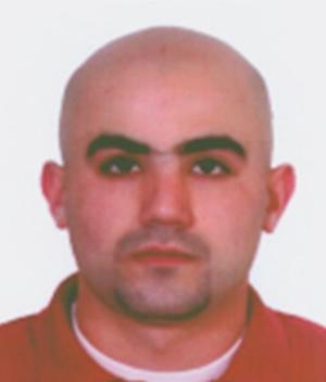 This photo provided by the Bulgarian Interior Ministry on Thursday, July 25, 2013 shows a headshot of Canadian citizen Hassan El Hajj Hassan who is suspected of having link with a bomb attack on the July 18, 2012 at Burgas airport in Bulgaria, that killed five Israeli tourists and a Bulgarian bus driver last year. (AP Photo/Bulgarian Interior Ministry)