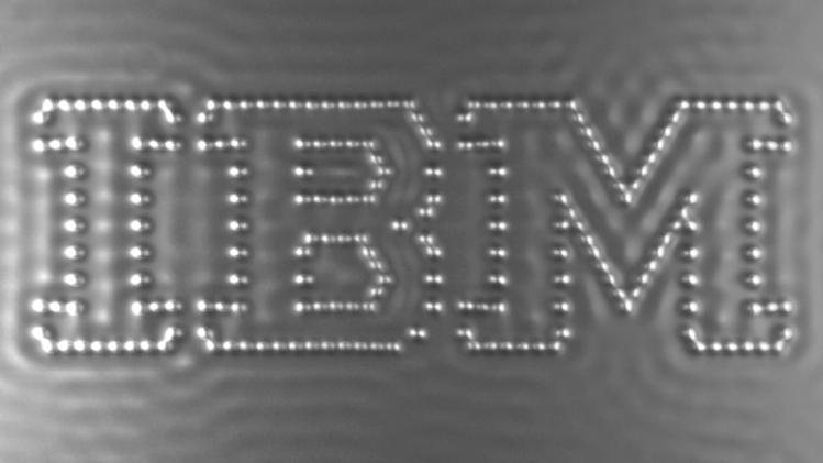"In this undated image taken from video and provided by IBM, carbon monoxide molecules are arranged on the screen to form the IBM logo, in what IBM claims to be the world's tiniest stop-action movie. Entitled ""A Boy and his Atom,"" the one minute video employs individual carbon monoxide molecules that are rearranged to show a boy carrying out various activities. Each of the 242 frames measures 45 by 25 nanometers which is one billionth of a meter. (AP Photo/IBM)"