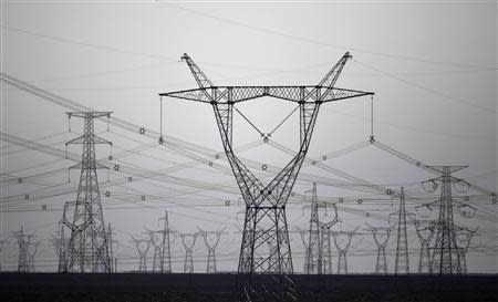 High voltage power lines are seen near a wind farm in Guazhou, 950km northwest of Lanzhou, Gansu Province