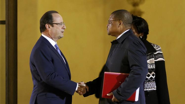 French President Hollande talks with Prime Minister Tiangaye of the Central African Republic after a meeting dedicated to the situation in the Central African Republic, at the Elysee Palace