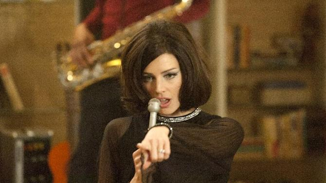 """This image released by AMC shows Jessica Pare as Megan Draper performing a French song in a scene from the season five premiere episode of """"Mad Men,"""" where Megan surprises her husband Don with a birthday party.  On Thursday, July 19, 2012, the program received a total of 17 Emmy nominations including best actress in a drama series for Elisabeth Moss and best actor for Jon Hamm. The 64th annual Primetime Emmy Awards will be presented Sept. 23 at the Nokia Theatre in Los Angeles, hosted by Jimmy Kimmel and airing live on ABC. (AP Photo/AMC, Ron Jaffe)"""