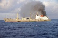 This photo released by the Japan Coast Guard shows smoke rising from the Chinese cargo ship Ming Yang at sea, around 150 kilometres southeast of Okinawa. All 64 Chinese seamen were saved from their 12,703-ton vessel by the Japan Coast Guard
