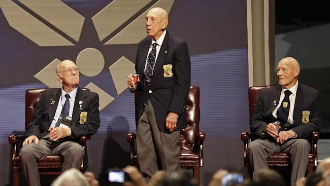FILE - In this Nov. 9, 2013 Richard Cole, center, proposes a toast with two other surviving members of the 1942 Tokyo raid led by Lt. Col. Jimmy Doolittle, Edward Saylor, left, and David Thatcher, at the National Museum for the US Air Force in Dayton, Ohio. The group will receive the Congressional Gold Medal on April 15, 2015, in Washington, then hand it over April 18 to the museum for display  its exhibit depicting the launch from an aircraft carrier of the Raiders' daring 1942 bombing attack on mainland Japan. (AP Photo/Al Behrman, File)