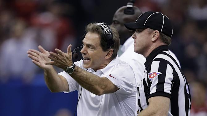 Alabama coach Nick Saban makes a point to an official during the first half of the Sugar Bowl NCAA college football game against Oklahoma, Thursday, Jan. 2, 2014, in New Orleans