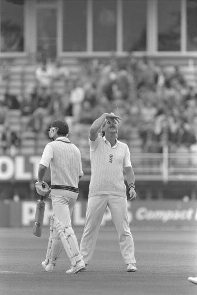 Aug 1985 : Ian Botham makes a gesture to the England dressing room as South African Kepler Wessels comes into bat for his adopted Australia during the 5th Test at Edgbaston.         Mandatory Credit: