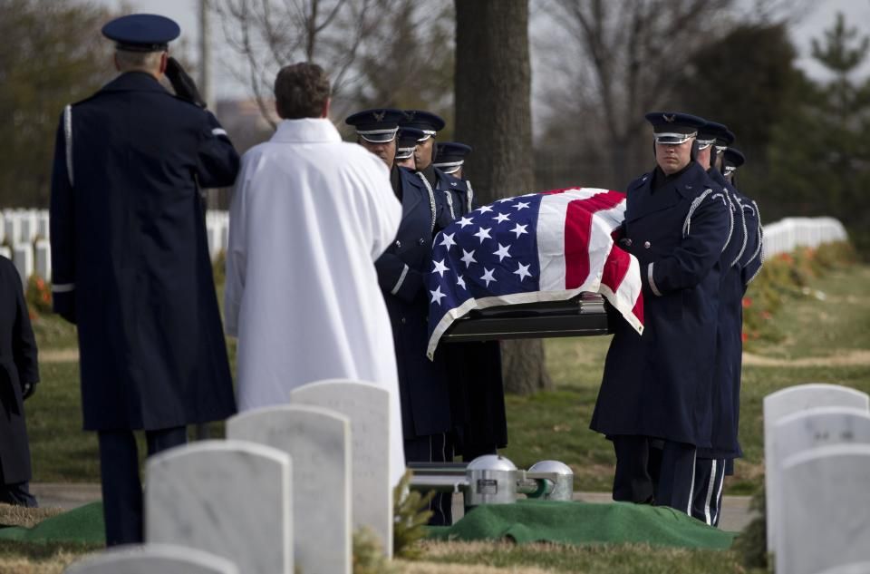 An Air Force honor guard carries the casket of former Tuskegee airman, retired Lt. Col. Luke Weathers during burial services at Arlington National Cemetery i Arlington, Va., Friday, Jan. 20, 2012.  (AP Photo/Evan Vucci)