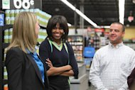 "Michelle Obama talks with Wal-mart executive Andrea Thomas as Stephen Roberts looks on during a tour the Walmart Neighborhood Market in Springfield, Mo. on Thursday, Feb. 28, 2013. Mrs. Obama was promoting her campaign against childhood obesity and highlit ""the groundbreaking steps"" the retailer has taken to make healthy food more affordable. (AP Photo/The Springfield News-Leader, Valerie Mosley) NO SALES"