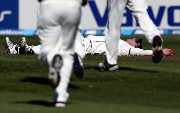 New Zealand's Rutherford lies on the ground after taking a catch to dismiss England's Bell for 24 runs during the second day of the first test at the University Oval in Dunedin