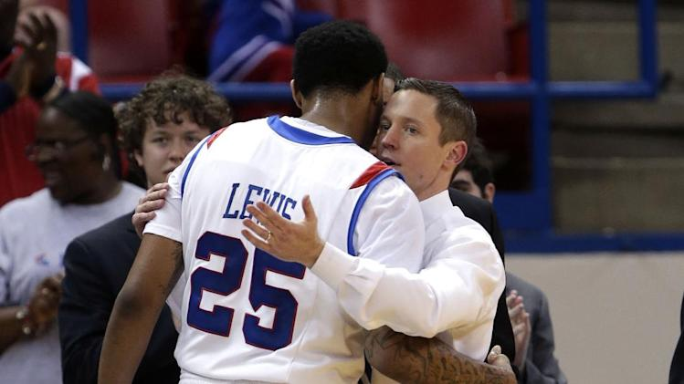 FILE - In this March 2, 2013, file photo, Louisiana Tech head coach Michael White hugs senior J.L. Lewis (25) in the closing minutes of Lewis' final home NCAA college basketball game against San Jose State in Ruston, La. In a season of parity that has produced quite a few surprises, a few of the unexpected turns, such as Louisiana Tech's success, have stood out. (AP Photo/Gerald Herbert, File)