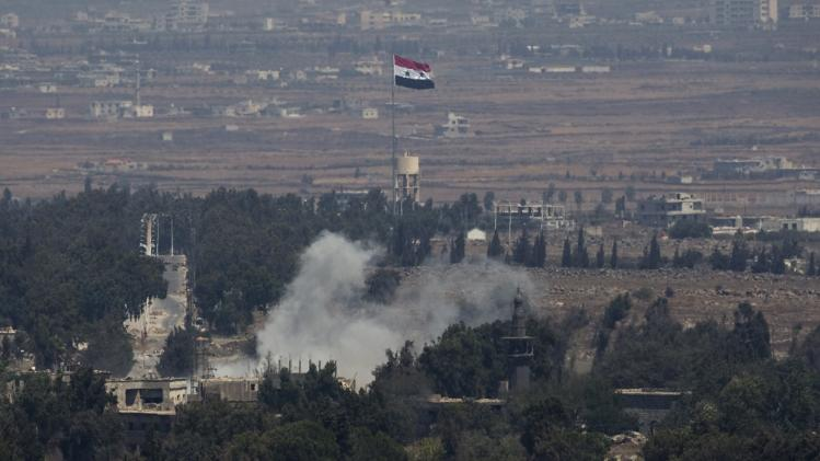 Smoke rises following an explosion on the Syrian side near the Quneitra border crossing