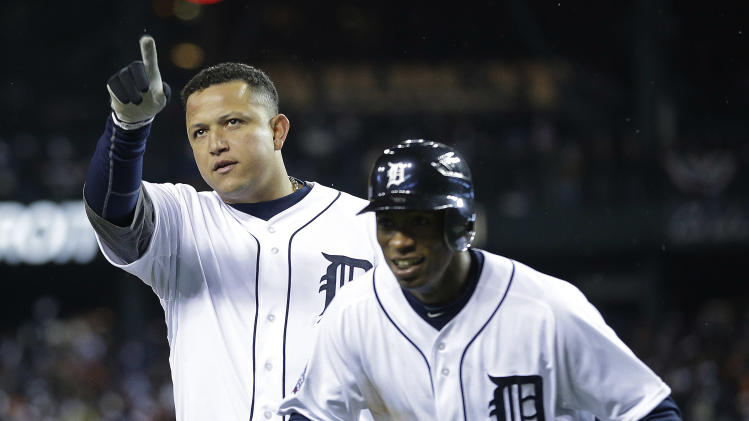 Detroit Tigers' Miguel Cabrera, left, reacts with Austin Jackson after hitting a two-run home run during the third inning of Game 4 of baseball's World Series against the San Francisco Giants Sunday, Oct. 28, 2012, in Detroit. (AP Photo/Matt Slocum)