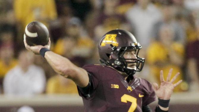 Minnesota quarterback Mitch Leidner looks to pass during the first half of an NCAA college football game Thursday, Sept. 3, 2015, against TCU in Minneapolis. (AP Photo/Paul Battaglia)