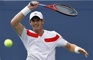 Murray of Britain hits a return to Mayer of Germany at the U.S. Open tennis championships in New York