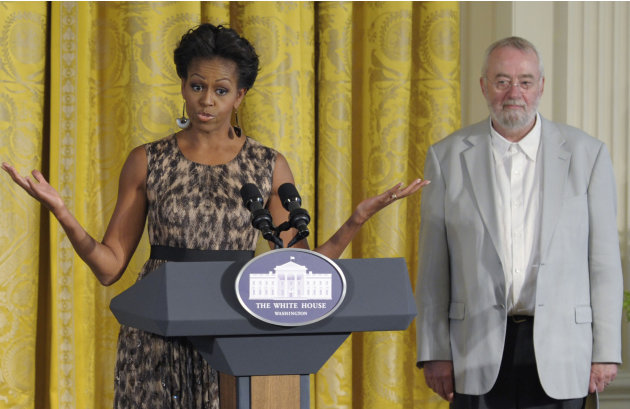 FILE - In this Tuesday, Sept. 13, 2011 file photo, Bill Moggridge, the director of the Smithsonian's Cooper-Hewitt, National Design Museum, stands at right as first lady Michelle Obama speaks in the E