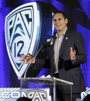 FILE - In this July 26, 2011, file photo, Pac-12 Commissioner Larry Scott talks during the Pac-12 NCAA college football media day in Los Angeles. The BCS commissioners, including Scott, are backing a playoff plan with the sites for the national semifinals rotating among the major bowl games and a selection committee picking the teams, Notre Dame Athletic Director Swarbrick said Wednesday, June 20, 2012. (AP Photo/Reed Saxon, File)