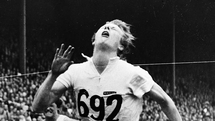 "FILE - This Aug. 4, 1948 file photo shows Fanny Blankers-Koen, of Netherlands, crossing the finish line of the 80-meter hurdle final of the 1948 Olympic Games at Wembley Stadium in London. Blankers-Koen, who was one of the biggest stars of the 1948 London Olympics, was originally left off a new map of the London Underground dedicated to past Olympians, prompting criticism from her homeland. But on Wednesday, April 4, 2012, the track star known as the ""Flying Housewife"" was added to the list for future prints. (AP Photo/File)"
