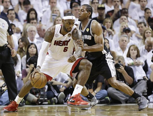 San Antonio Spurs' Kawhi Leonard (2) defends against Miami Heat's LeBron James (6) during the first half in Game 7 of the NBA basketball championships, Thursday, June 20, 2013, in Miami. (AP Photo/Lyn