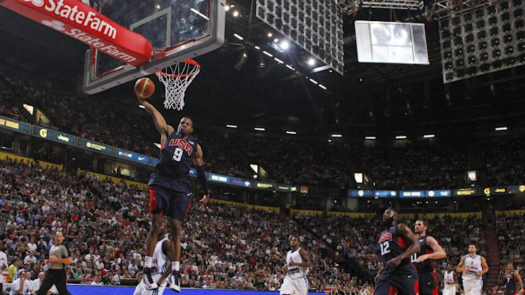 Andre Iguodala of the USA scores during an Olympic Warm Up match at the Manchester Arena, Manchester, England, Thursday July 19, 2012.  Competitors from around the globe are arriving in London to prepare for the upcoming London 2012 Olympic Games. (AP Photo / Dave Thompson, PA) UNITED KINGDOM OUT - NO SALES - NO ARCHIVES