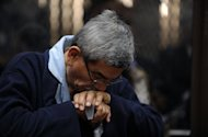 Retired general Jose Rodriguez reacts during a court hearing in Guatemala City on January 28, 2013. A judge decided to open a genocide trial against Rodriguez, a former member of the military leadership who arrived in court in a wheelchair