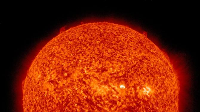 This image captured in the 304 Angstrom wavelength, which is typically colorized in red provided by NASA shows a solar flare, lower center, erupting from the sun on Thursday, July 12, 2012. Space weather scientists said there should be little impact to Earth. The flare erupted from a region which rotated into view on July 6, 2012. (AP Photo/NASA)
