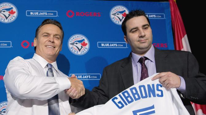 Toronto Blue Jays General Manager Alex Anthopoulos, right, introduces new Blue Jays manager John Gibbons, left, before speaking to the media during a press conference in Toronto on Tuesday, Nov. 20, 2012. (AP Photo/The Canadian Press, Nathan Denette)
