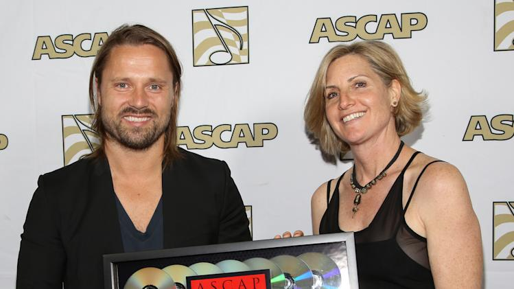 Songwriter of the Year Max Martin and ASCAP Vice President, Membership - Pop/Rock Sue Drew arrive at the 30th Annual ASCAP Pop Music Awards, on Wednesday, April 16, 2013, at Loews Hollywood Hotel in Hollywood, California. (Photo by Brian Dowling/Invision for ASCAP/AP Images)