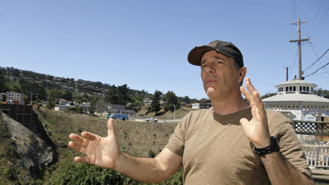 Phil Piserchio stands on his deck recalling last year's gas pipeline explosion with the epicenter in the background in San Bruno, Calif., Tuesday, Aug. 30, 2011. A federal safety panel unanimously concluded Tuesday that a series of actions by one of the nation's largest gas companies caused a gasexplosion last year that killed eight people and incinerated a suburban neighborhood near San Francisco. Piserchio hoped that the safety panel's report would improve both the infrastructure of gas lines and public safety. (AP Photo/Eric Risberg)