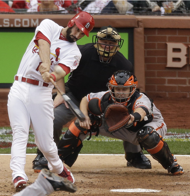 St. Louis Cardinals' Matt Carpenter (13) hits a two-run home run during the third inning of Game 3 of baseball's National League championship series against the San Francisco Giants, Wednesday, Oct. 1