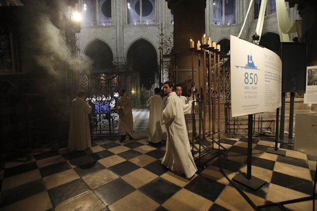 Religious dignitaries attend a ceremony at Paris' Notre Dame Cathedral for its 850th anniversary , Wednesday, Dec. 12, 2012. Paris' Notre Dame Cathedral is kicking off its 850th anniversary celebratio
