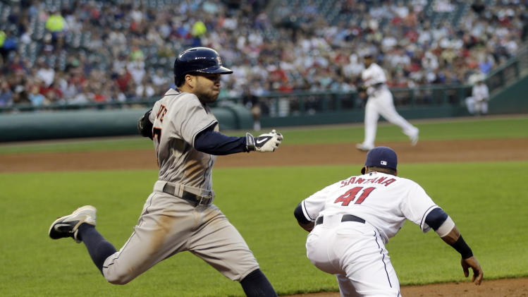 Houston Astros' Jose Altuve is out by a step at first ion a ground ball in the third inning of a baseball game against the Cleveland Indians Friday, Aug. 22, 2014, in Cleveland. (AP Photo/Mark Duncan)