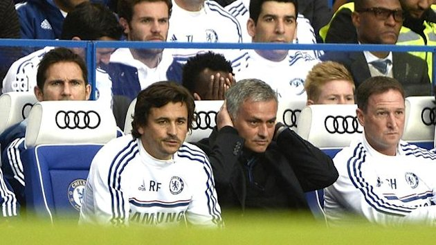 Juan Mata sits behind the Chelsea bench (Reuters)