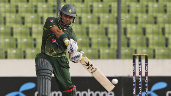 Pakistani cricketer Mohammad Hafeez bats during their second one-day international cricket match against Bangladesh in Dhaka, Bangladesh, Saturday, Dec. 3, 2011. (AP Photo/Pavel Rahman)
